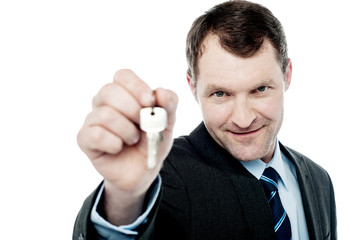 Handsome realtor offering house key
