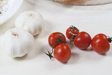 Fresh cherry tomato and garlic on the table.