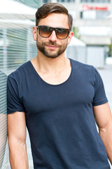 Young athletic man with sunglasses