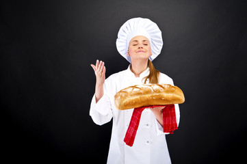 Chef baker smelling fresh baked bread.