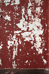 Background peeled brawn scarlet paint on the wall.