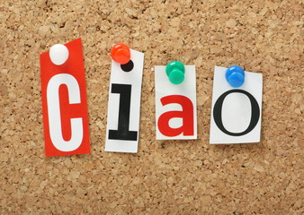 The Italian word Ciao in magazine letters on a cork notice board