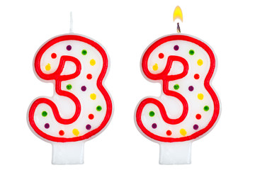 Birthday candles number three isolated on white background