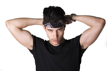Handsome young man tying a bandanna