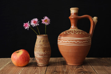 Ceramic jug and three flower