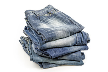 Folded Old Blue Jeans Isolated on a white. Clipping path