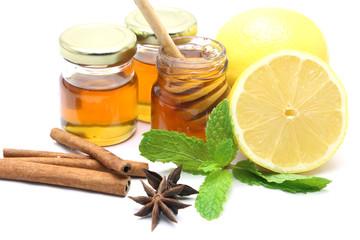 Honey and lemon on white background