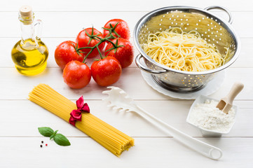 Spaghetti and ingredients on the table