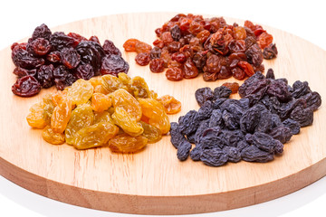 Four different handfuls of raisins