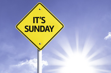 It's Sunday road sign with sun background