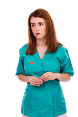 Portrait of thoughtful female doctor or nurse