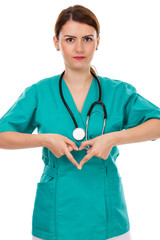 Attractive female doctor with stethoscope making heart shape