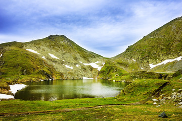 Capra Lake and Fagaras mountains in Romania