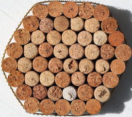 stand under a hot dish. corks from wine bottles