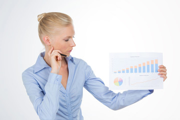 blond business woman explaining a graphic on a chart
