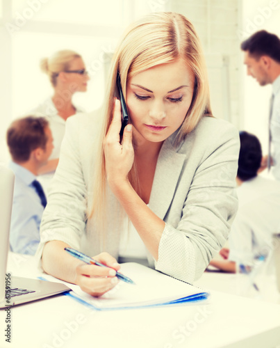 canvas print picture businesswoman with phone in office