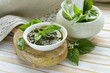 pesto sauce of fresh green basil leaves with olive oil