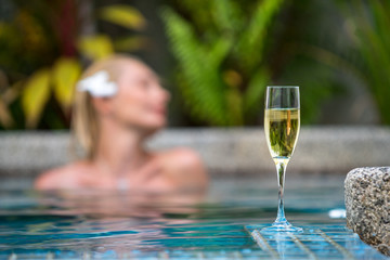 Champagne near swimming pool on a background