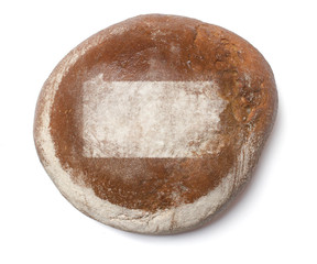 A loaf of fresh bread covered with rye flour in the shape of Pen