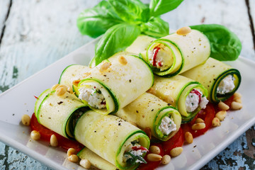 zucchini rolls with feta cheese and pine nuts