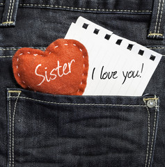 Sister I love you! written on a peace of paper