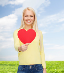 smiling woman with red heart