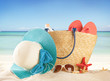 canvas print picture - Sandy beach with accessories and blur sea