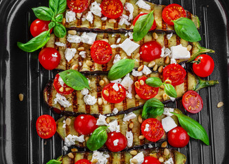 grilled eggplant with feta cheese and cherry tomatoes