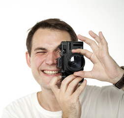 Happy young men using a camera to take photo