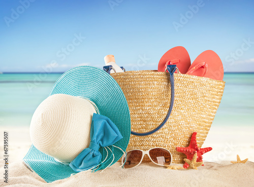canvas print picture Sandy beach with accessories and blur sea