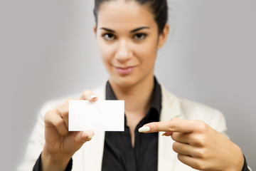 Young woman holding a blank card