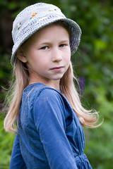 little girl in blue hat