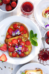 Delicious breakfast. French toasts with fresh strawberry