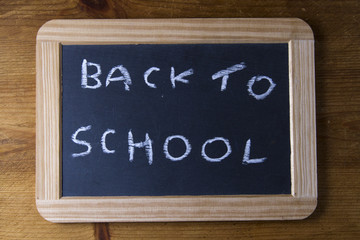 Back to school, written on replica old blackboard writing slate.