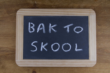 Bak to skool, back to school written on replica old blackboard w