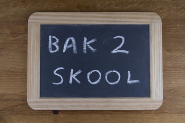 Bak 2 skool, back to school written on replica old blackboard wr