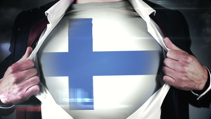 Businessman opening shirt to reveal finland flag