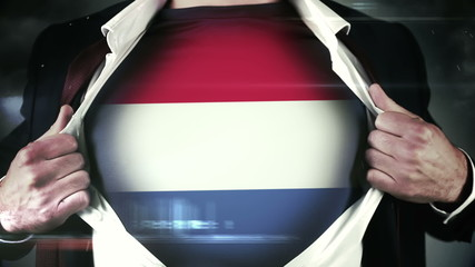 Businessman opening shirt to reveal dutch flag
