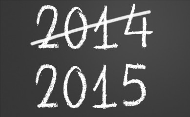 2014 crossed and new year 2015 on chalkboard