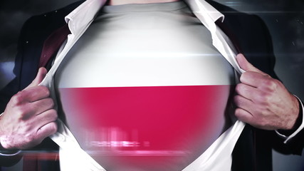 Businessman opening shirt to reveal polish flag