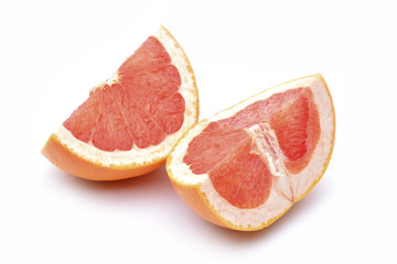 Slices of grapefruit on a white background.