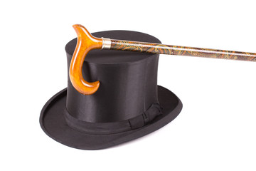 Black silk hat and walking stick on white background
