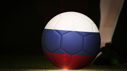 Football player kicking russia flag ball