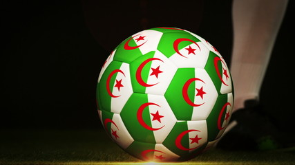 Football player kicking algeria flag ball