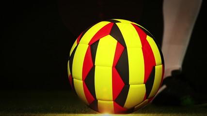 Football player kicking belgium flag ball