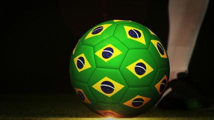 Football player kicking brazil flag ball