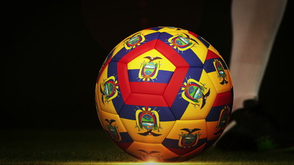 Football player kicking ecuador flag ball