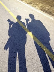 two shadows of two photographers