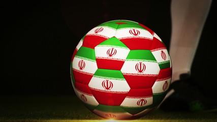 Football player kicking iran flag ball
