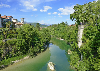 Natisone River in the medieval town Cividale del Friuli, Italy.
